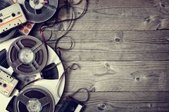 Old audio reels and cassette tape background. Retro audio reels and cassette tape with copyspace royalty free stock image