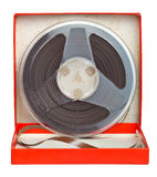 Old audio tape on a red box Royalty Free Stock Photography