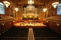 Old auditorium. Gold and velvet decoration Royalty Free Stock Images