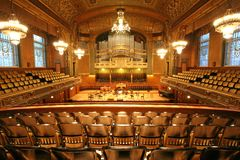 Old auditorium. Gold and velvet decoration Royalty Free Stock Photos