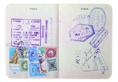 Old passport page with visa stamps. Old Australian passport with visa stamps for Egypt on the pages isolated on white background Stock Image