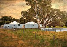 Old Australian sheep shearing sheds. And yards with retro grunge filter Royalty Free Stock Image