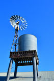 An old Australian windmill pump and water tank Stock Photo