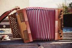 Old Austrian Accordion. One old Austrian accordion, details of decoration royalty free stock photos