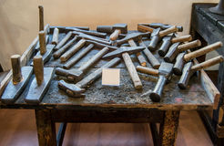 Old, authentic hammers from the museum of ancient crafts in the city of Valli del Pasubio, Italy Royalty Free Stock Photography
