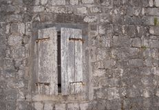 Ajar window. Old authentic window in stone wall Royalty Free Stock Image