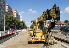 Old auto crane on a streetcar construction site Royalty Free Stock Photo