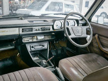 Old automobile interior with dashboard and big wheel Stock Photography