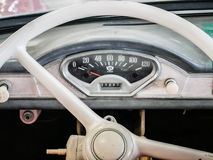 Old automobile interior with dashboard and big wheel Royalty Free Stock Photography