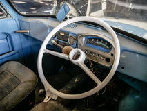 Old automobile interior with dashboard and big wheel. Dashboard of old car with big wheel, nostalgia for a time which has passed, old automobile interior Royalty Free Stock Photos