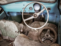 Old automobile interior with dashboard and big wheel. Dashboard of old car with big wheel, nostalgia for a time which has passed, old automobile interior Royalty Free Stock Images