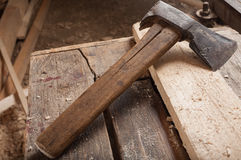 Old ax or hatchet on a wood Stock Photos