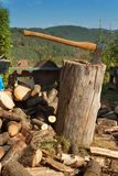 Old ax on log and firewood. Axe Cut into Wood after Chopping Firewood. Stock Photo