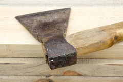 Old ax lying on the boards Royalty Free Stock Photos