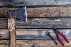 Old ax and other tools lying on the boards Stock Image