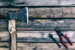 Old ax and other tools. Retro style photo Stock Images
