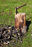 Old ax stuck in a wooden log Royalty Free Stock Photography