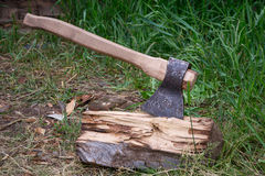 Old ax with wood. Royalty Free Stock Image