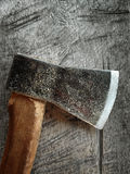 Old axe. An old axe over the wooden background Royalty Free Stock Photo