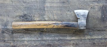 Old axe against wooden plank. Tool series stock photos