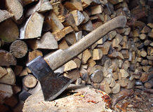 Old axe and firewood Stock Photography