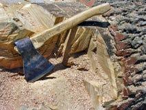An old axe on the oak log Stock Photos