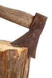 Old axe stuck in log Royalty Free Stock Image