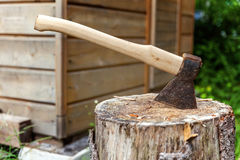 Old axe in stump Royalty Free Stock Photography