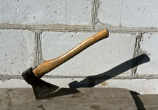 Old axe in wood plank. Stock Photo