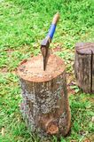 An old axe stuck in a stump Royalty Free Stock Photography