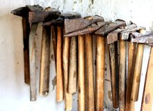 Old axes. Old rusty axes on the white wall Royalty Free Stock Photography