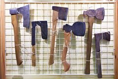 Old axes in window of antique store Royalty Free Stock Image