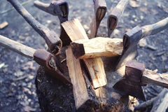 Old axes in a woodpile with chipped firewood. Royalty Free Stock Photo