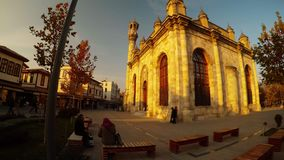 Old Azizia mosque in the Sufi Turkish city of Konya in the rays of the evening sun. KONYA / TURKEY - 11.20.2016 central streets of the ancient Turkish city stock video footage