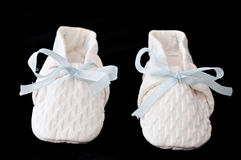Old baby booties Stock Photos