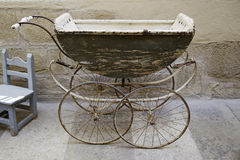 Old baby carriage. Antique antique piece Stock Photography