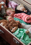 Old baby dolls. Old baby dolls, folded in the suitcase Royalty Free Stock Photo
