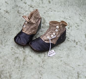 Old baby shoes at flea market Stock Image