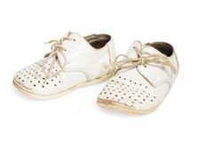 Old baby shoes isolated on white background Stock Photos