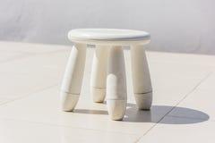 Old baby white plastic stool Stock Photo