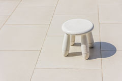 Old baby white plastic stool Royalty Free Stock Photography