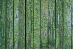 Old background with green paint. Old shabby wooden background with green paint Royalty Free Stock Image