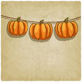 Old background with pumpkins on rope Royalty Free Stock Photography
