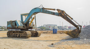 Old backhoe dozer on site. Construction industrial stock photography