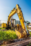 Old backhoe and steel rods at construction site Stock Image