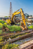 Old backhoe and steel rods at construction site Royalty Free Stock Image
