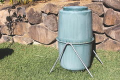 Old Backyard Compost Bin. Typical rotating plastic compost bin Stock Photo