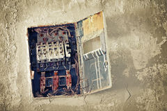 Old bad rusty switch box on wall Stock Image