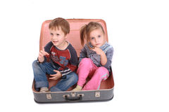 Old bag and twins. Kids in the bag on the white background Stock Photos