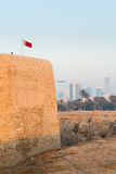 Old Bahrain Fort at Seef in late afternoon. Dusk at the recontructed Bahrain Fort near Manama at Seef, Bahrain Stock Photo